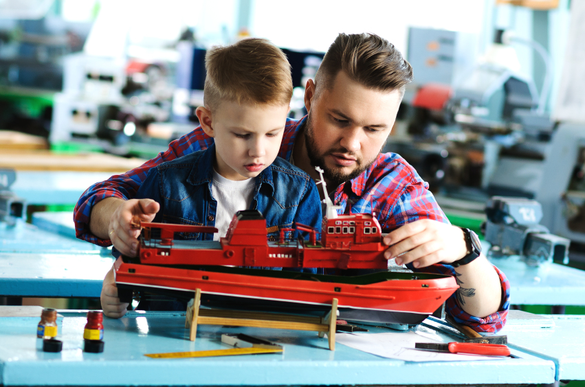 Father and son collect ship model